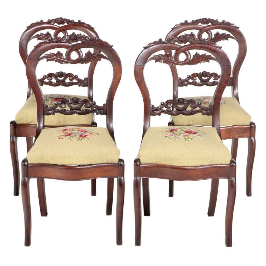 Four American Rococo Revival Rosewood-Grained Walnut and Needlepoint Side Chairs