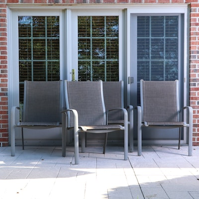 Set of Four Gray Aluminum Sling Patio Armchairs