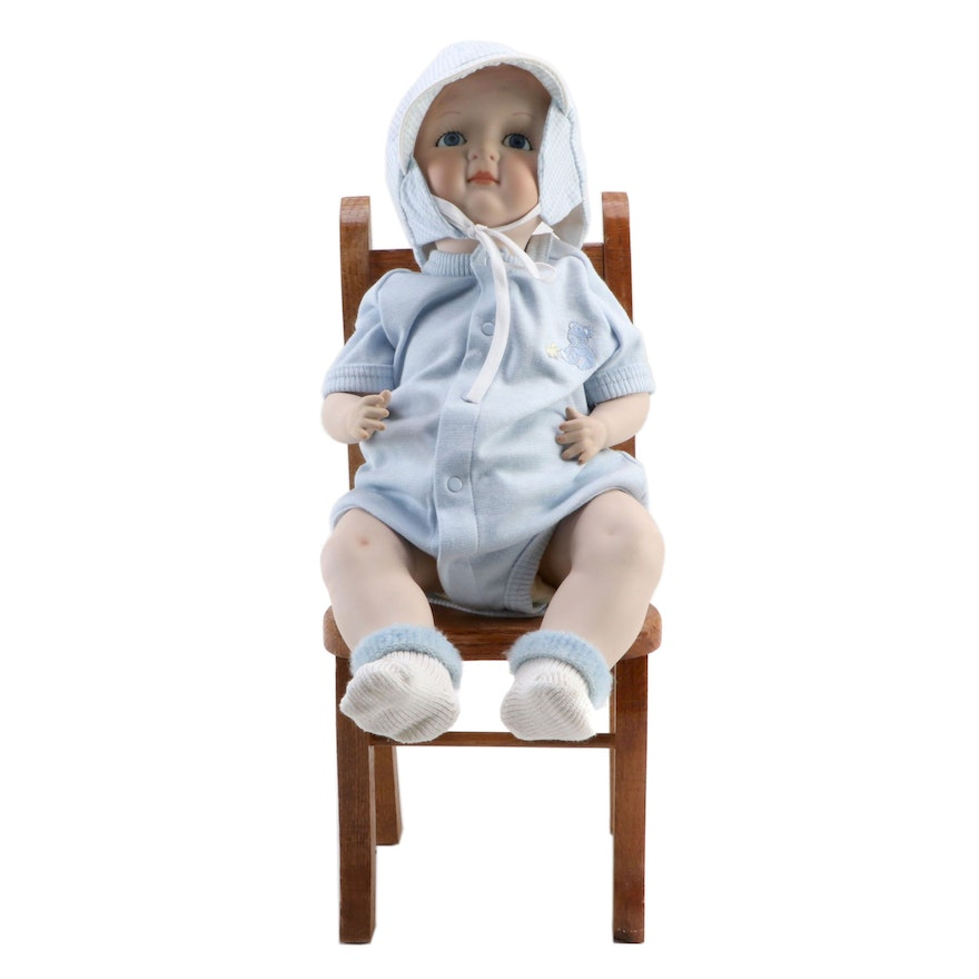 German-Style Ceramic Baby Doll with Wooden Chair, Late 20th Century