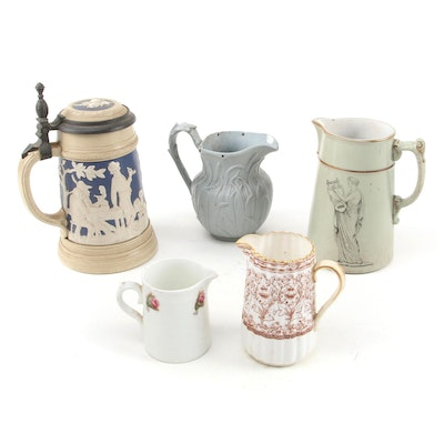 """Mettlach """"Peasants Bowling"""" Ceramic Stein with Other Ceramic Pitchers"""