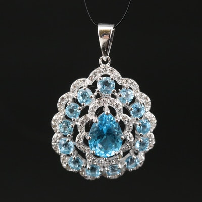 Sterling Pendant with Scalloped Edges Set with White and Swiss Blue Topaz