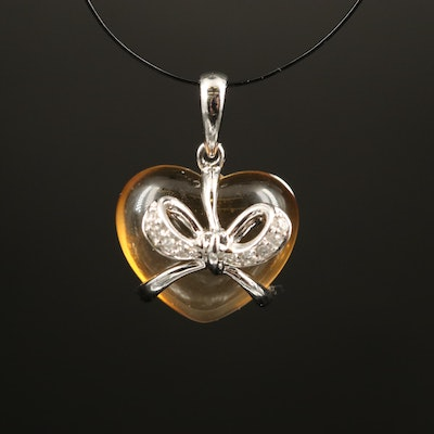 18K Citrine Heart Pendant Wrapped In a Diamond Accented Bow