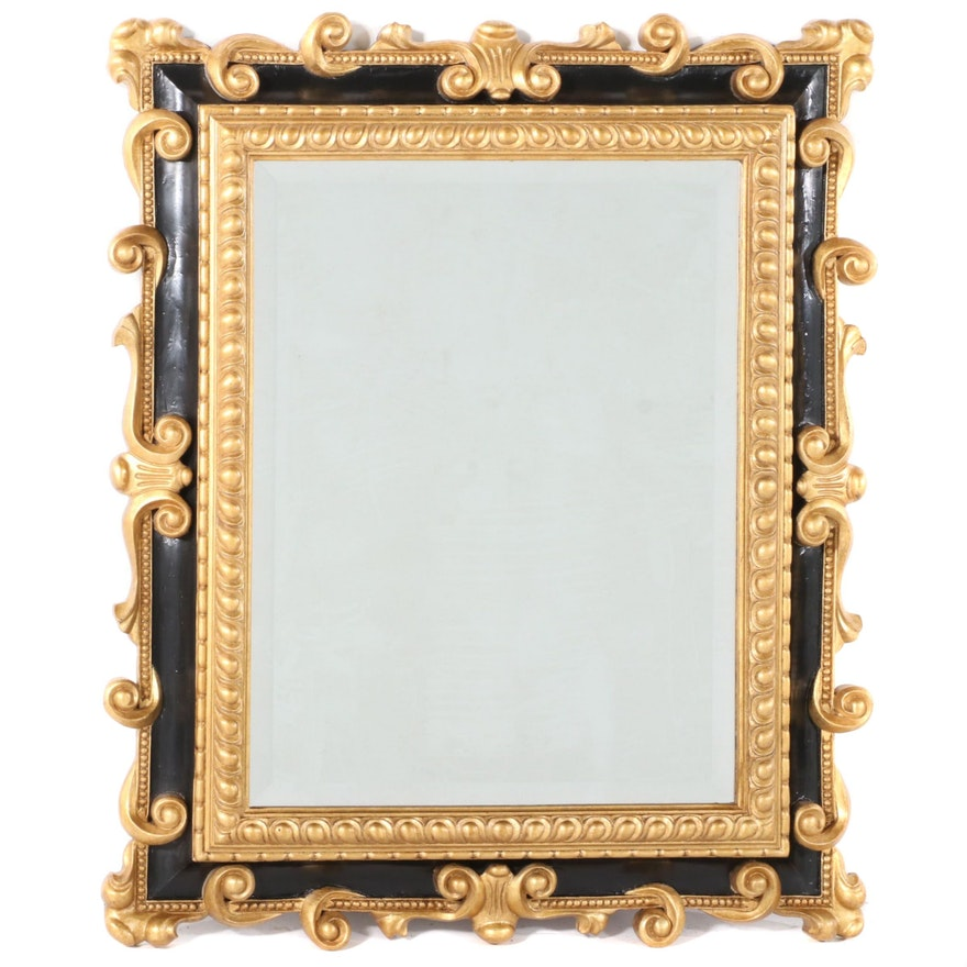 Baroque Style Ebonized and Parcel-Gilt Composite Mirror