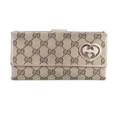 Gucci Interlocking G Heart Continental Wallet in GG Canvas and Leather Trim