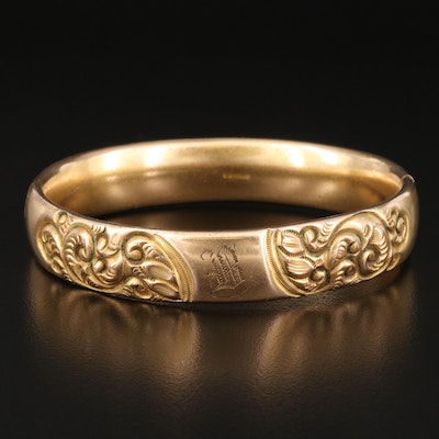 Vintage Hinged Bangle with Repousse Scroll Motif