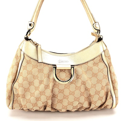 Gucci Abbey D-Ring Hobo Bag in GG Canvas and Gold Metallic Leather