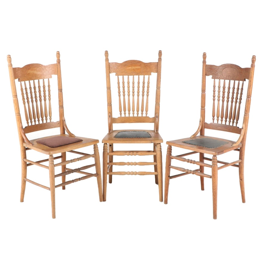 Three Late Victorian Oak Spindle and Pressed-Back Dining Side Chairs