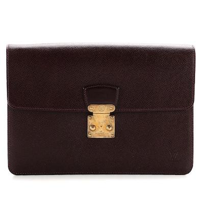 Louis Vuitton Kourad Clutch in Bordeaux Taïga Leather