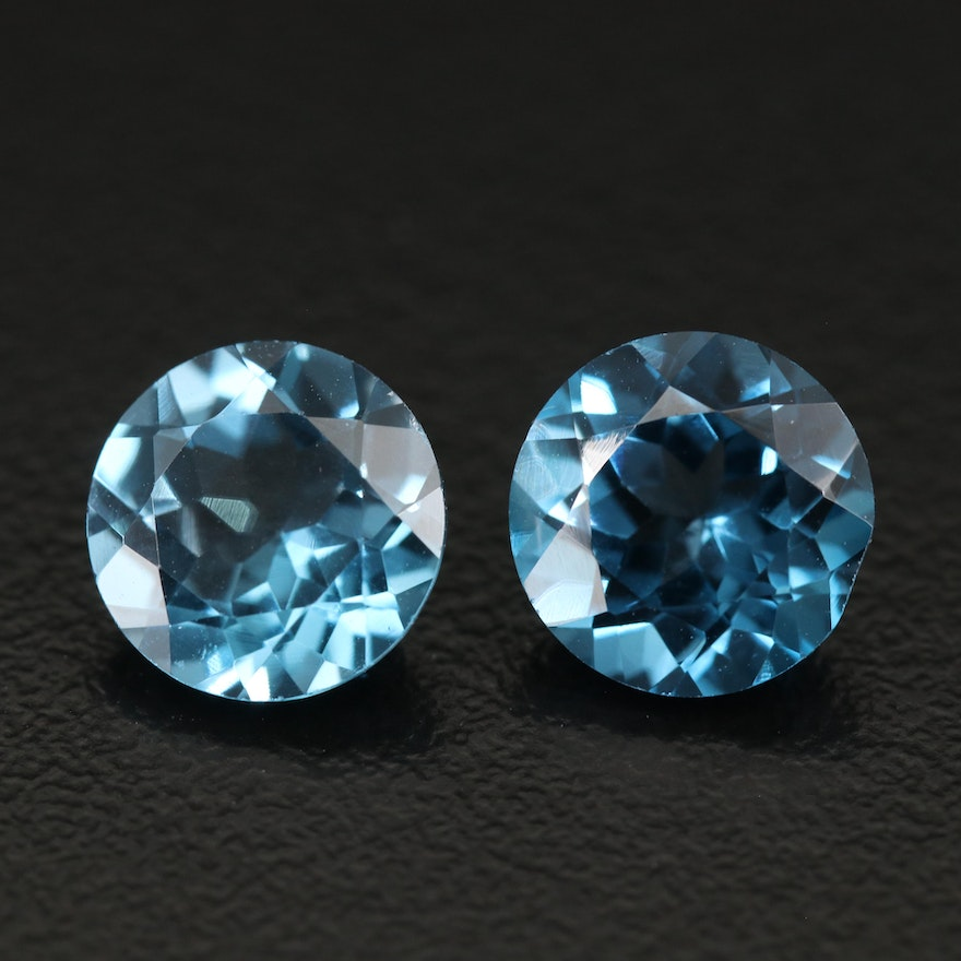 Matched Pair of Loose 6.38 CTW Round Faceted Blue Topaz
