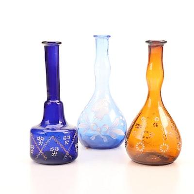 Enamel-Decorated Cobalt, Light Blue and Amber Glass Dresser Bottles