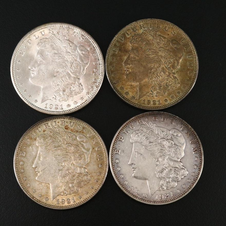 Four 1921 Morgan Silver Dollars