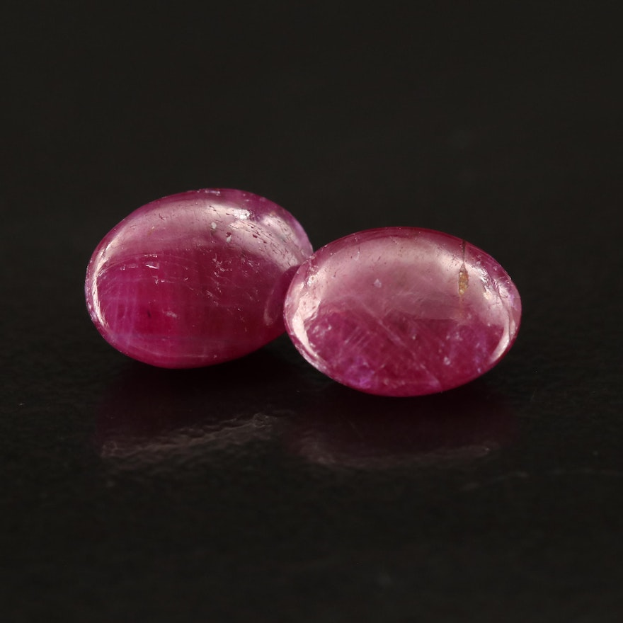 Matched Pair of Loose 4.14 CTW Oval Ruby Cabochons