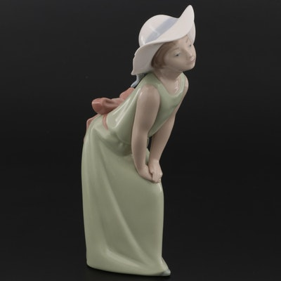 """Lladró """"Curious Girl with Straw Hat"""" Figurine Designed by Francisco Catalá"""