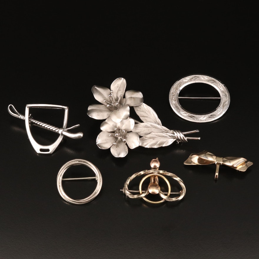 Brooches with Flower and Oval Designs and Sterling Silver