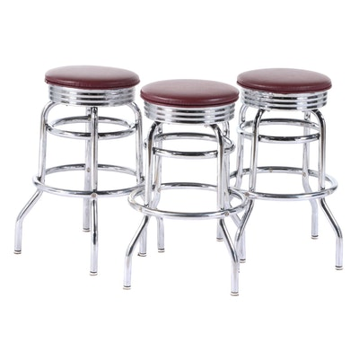 Three Modernist Style Chrome Swivel Counter-Height Bar Stools