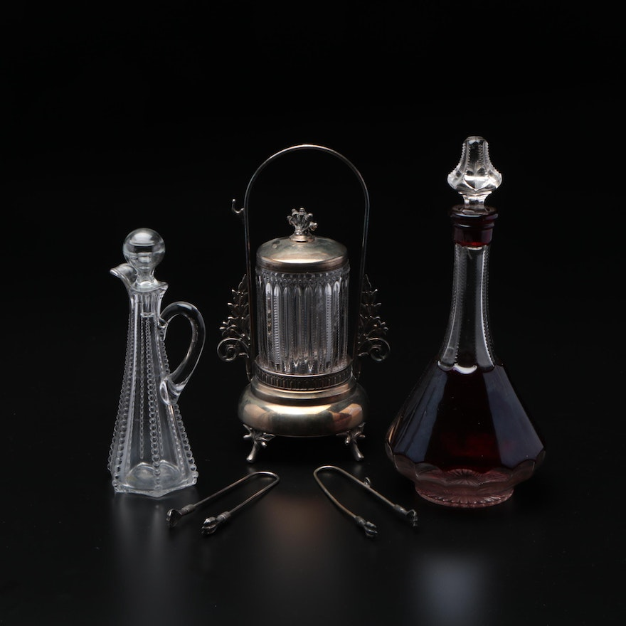 Victorian Silver Plate and Glass Pickle Castor with Glass Ewer and Decanters