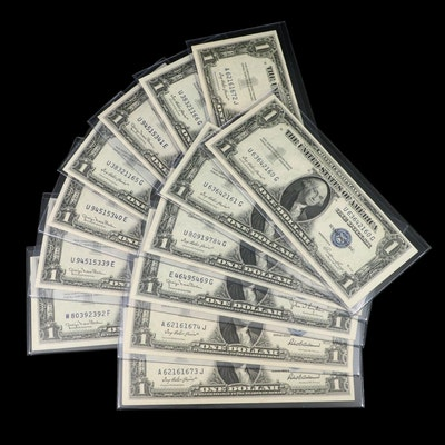 Thirteen Uncirculated $1 Silver Certificates