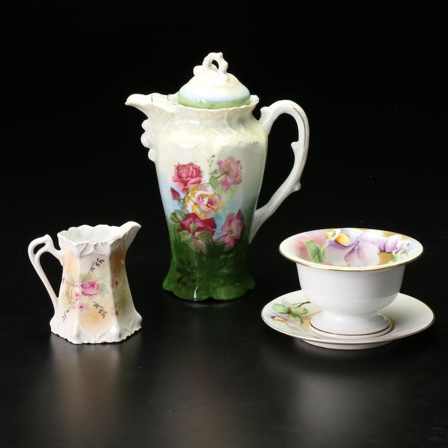 Meito and Various German Porcelain Chocolate Pot, Creamer, Teacup and Saucer