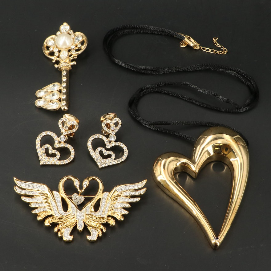 Rhinestone Brooches, Earrings and Necklace Featuring Nolan Miller