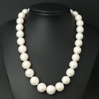 Strand of Near Round Pearls with 14K Closure