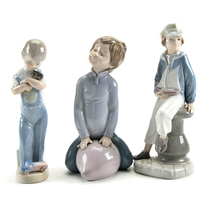 """Lladró """"Boy with Yacht"""" and """"Mechanic Boy"""" with Zaphir Porcelain Figurines"""