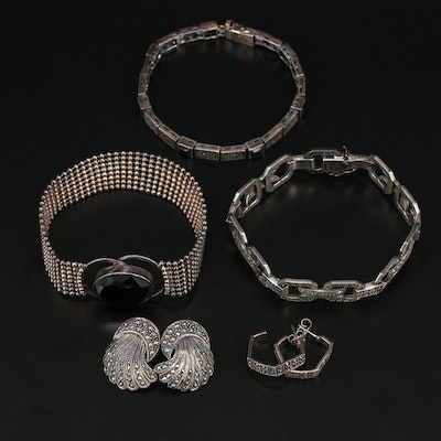 Sterling Silver Bracelets and Earrings Featuring Judith Jack