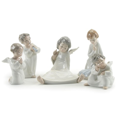 """Lladró """"Angel Thinking"""", """"Angel with Flute"""" and Other Porcelain Angel Figurines"""