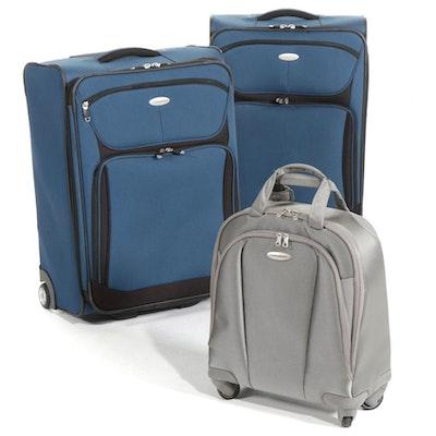 Three Samsonite Rolling Suitcases