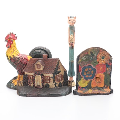 Cast Iron Doorstops and Figurine, including Rooster, Cottage, and Flowers
