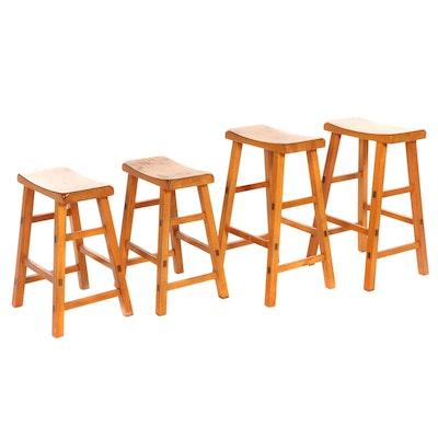 Four Wooden Saddle Style Barstools