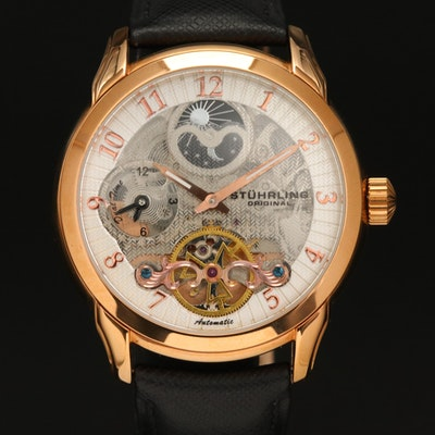 Stührling Dual Time Skeleton Gold Tone Automatic Wristwatch