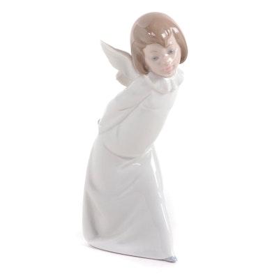 "Lladró ""Curious Angel"" Porcelain Figurine Designed by Salvador Debón"