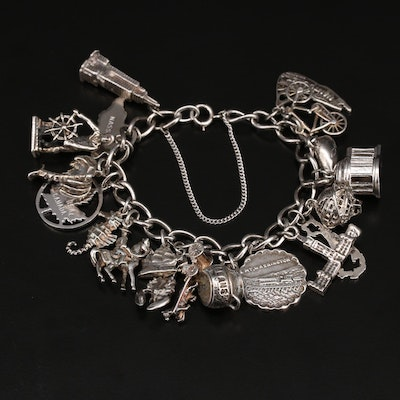 Sterling Charm Bracelet Featuring Travel Charms and English Seahorse