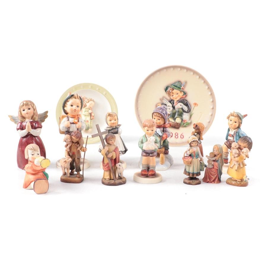 Anri Wood Figurines and Goebel Porcelain Hummel Figurines