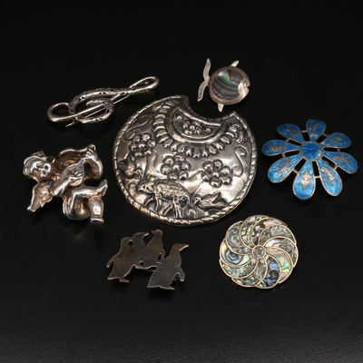 Sterling Brooches Including Flowers, Penguins and a Cherub