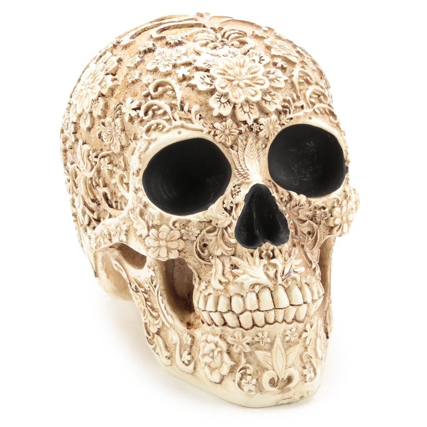 Carved Resin Skull Figurine With Floral Motif