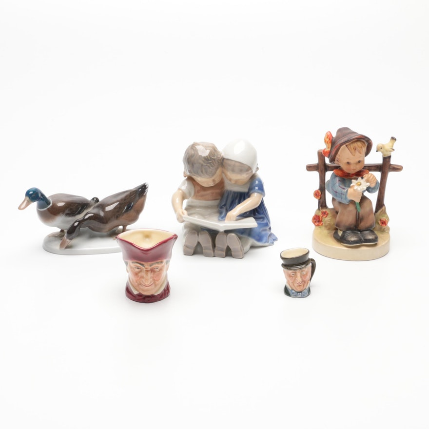 Royal Copenhagen Porcelain Figurines with Royal Doulton Mugs and Goebel Figurine