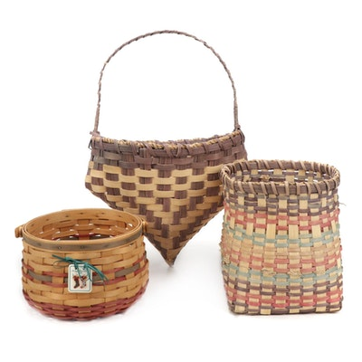 Carnation Basket Company Handled Basket With Other Handwoven and Dyed Baskets