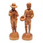 Pair of Wooden Cowboy Statuettes