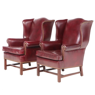 Two Hancock & Moore Mahogany and Studded Burgundy Leather Wingback Armchairs