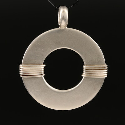 Sterling Silver Circle Pendant with Wrapped Details