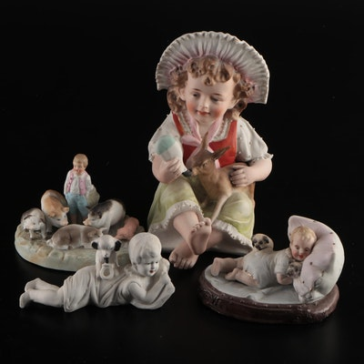 Young Boy Feeding Deer and Other Ceramic Figurines