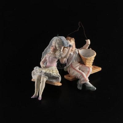 Ceramic Boy and Girl in Swings Figurines