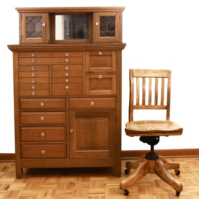 The American Cabinet Co. Oak and Leaded Glass Dental Cabinet and Desk Chair