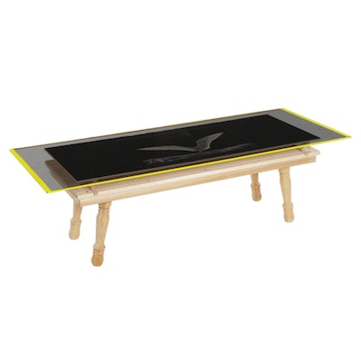 Wood Coffee Table with Glass Top Over Photograph of Bird