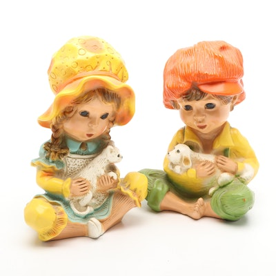 Universal Statuary Corp. Boy and Girl Resin Figurines, Late 20th C.