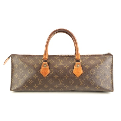 Louis Vuitton Sac Triangle in Monogram Canvas and Vachetta Leather
