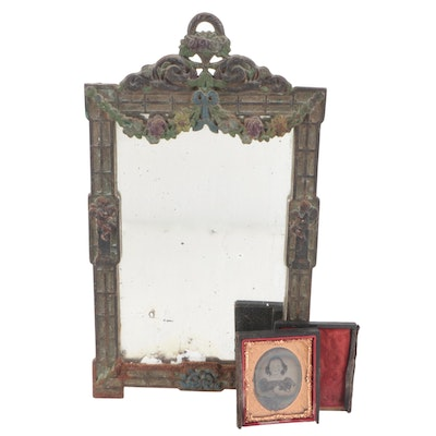 Iron Mirror with Floral Decoration and an Ambrotype Portrait of a Young Woman