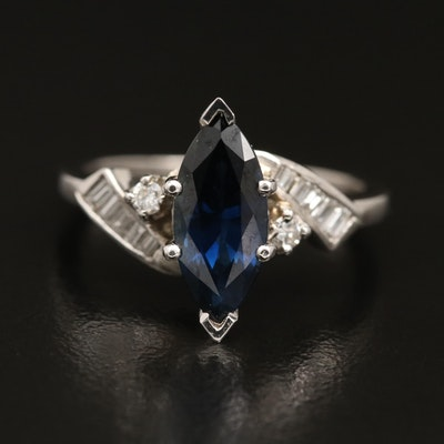 Platinum Sapphire and 0.21 CTW Diamond Ring