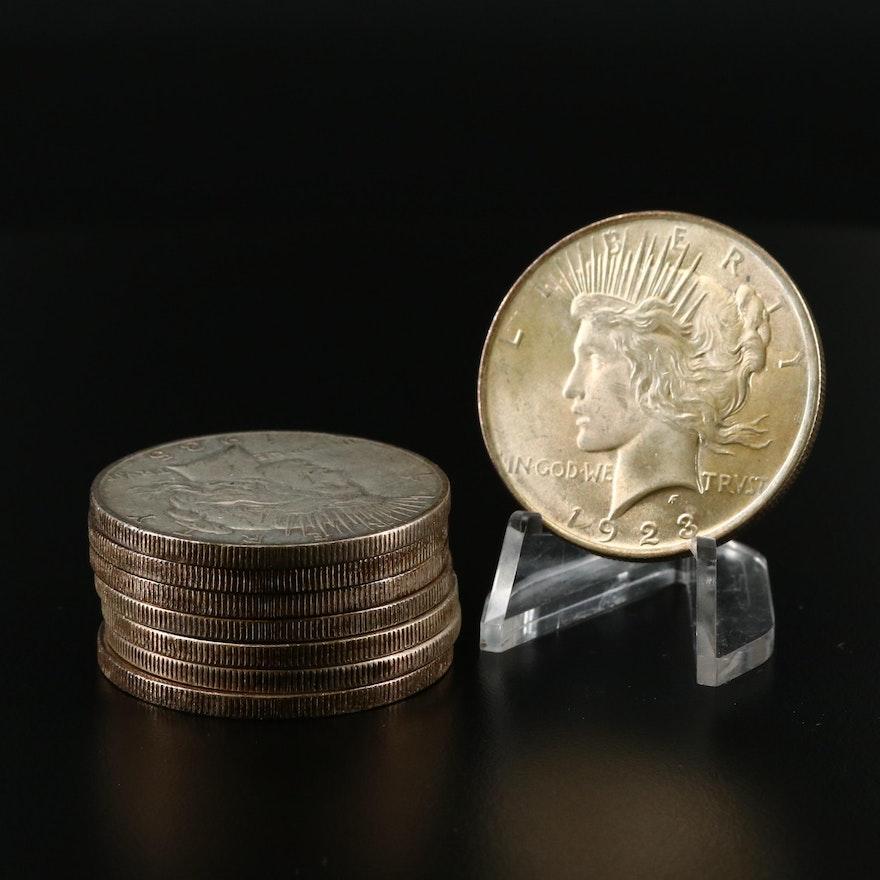 Eight Peace Silver Dollars